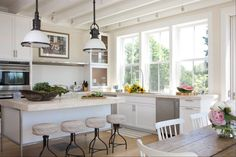 Benjamin Moore Sail Cloth, Visual Comfort Large Country Industrial Pendant, Salt Chair, contemporary raised kitchen island, no uppers | Kate Jackson Design
