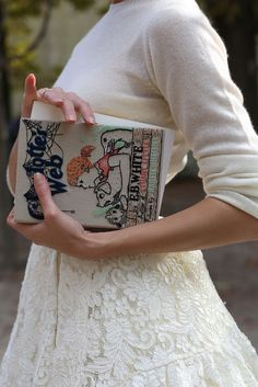 This photo reminds me of my daughter...naturally, classically chic, proper and always carrying a book!