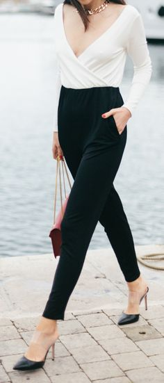 Chic with black pants, points and a simple white cross over. Making a statement without saying anything.