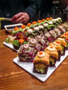 Mighty Mushroom (pictured above, 2nd row).  This roll comes with six-grain rice, enoki and shiitake mushrooms, tofu, and micro arugula.  It's served with an incredible shiitake teriyaki sauce.  Mushroom lovers, this one is for you.