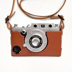 Gizmon iCa Leather Case & Strap By Four Corner Store This leather case completes the vintage look and allows you to wear your retro-style camera/iPhone for all to see. All ports are accessible with the case, which slides easily on and off. www.inbrook.com