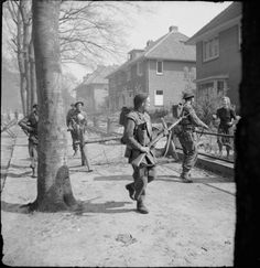 Infantry of the 11th Royal Scots Fusiliers, 49th (West Riding) Division, searching houses in Ede in The Netherlands, 17 April 1945.