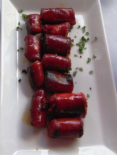 Chistorra (Basque: txistorra, [tʃis̺ˈtora]) is a type of fast-cure sausage from Aragon, the Basque Country, and Navarre, Spain. It is made of minced pork, or a mixture of minced pork and beef, is encased in either lamb tripe or plastic, and has a fat content that varies between 70 and 80%. The sausage is flavoured with garlic, salt, and paprika, which gives it a bright red colour. It is usually baked, fried, or grilled and often accompanies other dishes, sometimes as part of tapas.