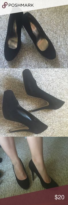 Black Suede Pumps Pre-owned. Great condition, signs of wear on the inside sole, as seen in 4th picture. Comfortable shoes, nice black suede look. Heels show minimal signs of wear, just a little dirt but would be easy to clean with some shoe polish. Taking offers! Bakers Shoes Heels
