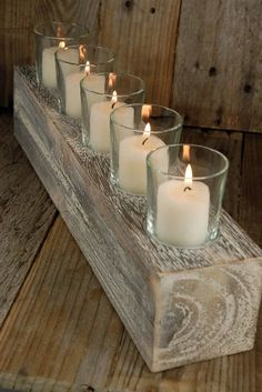 Rustic wood and candle centerpiece or decor piece by KraftyCounsel, via Etsy.