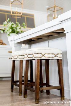 Backless brass nailhead island stools