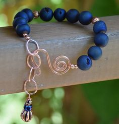 Dark Blue Druzy Agate Gemstone Bracelet with Bare Copper Wire Clasp and Chain.   Bracelet is adjustable length.  7-8.5 inch bracelet.