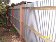 Fences Made With Tin Outdoors Corrugated Metal Fence Painted Green Remodelista