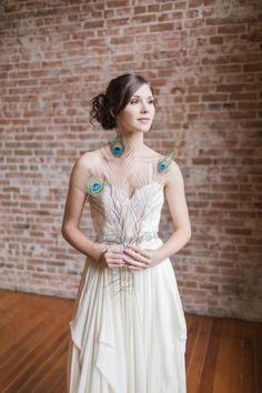 Peacock theme wedding.  Wedding dress by Leanne Marshall and from Beloved Bridal in Redlands.  Venue:  Speakeasy on State Redlands.  Photographer:  www.leahvis.com
