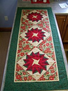 My christmas table runner ... center block pointsettia paper pieced