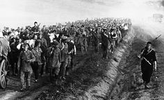 37 An column of Russian prisoners of war taken during recent fighting in Ukraine, on their way to a Nazi prison camp on September 3, 1941. (AP Photo) #