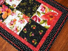 Quilted Table Runner with Roses - Black and White Table Runner - Red Pink and Orange Flowers by susiquilts on Etsy