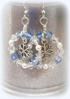 Snowflake circle dangle earrings are the perfect compliment to that Winter outfit. Sterling Silver Snowflake Charms are surrounded by Swarovski Lt. Sapphire and Crystal Bicone crystals along with White glass Pearls and Silver-plated Pewter Daisy s I Love Jewelry, Jewelry Design, Jewelry Making, Making Bracelets, Cheap Jewelry, Unique Jewelry, Chain Bracelets, Necklaces, Gold Bracelets