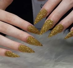 Custom gold glitter stiletto nails