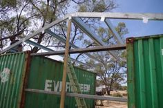 How to build your own shed using shipping containers, with many photos and instructions for each step of the way