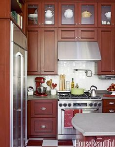 Home Depot designer Emily O'Keefe added stacked cabinetry with period charm to this small kitchen. can you use home depot cabinets and double stack? change the color but otherwise quite nice Top Of Cabinets, Kitchen Cabinets, Glass Cabinets, Tall Cabinets, Display Cabinets, Cherry Cabinets, Island Kitchen, Custom Cabinets, Storage Cabinets