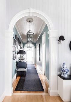 Flooding a hallway with plenty of natural sunlight is a sure-fire way to wow your guests. Alternatively, make a statement by installing a set of pendant lights or a chandelier. *Photo: Maree Homer / bauersyndication.com.au*