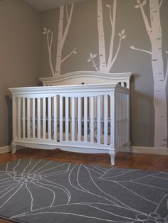 Baby H's gray and white nursery with tree decals and ikea rug