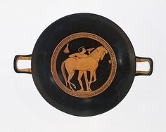 Terracotta kylix (drinking cup)  Attributed to Onesimos     Period:      Archaic  Date:      ca. 490 B.C.  Culture:      Greek, Attic  Medium:      Terracotta  Dimensions:      H. 3 9/16 in. (9 cm) diameter 12 1/4 in. (31.1 cm)  Classification:      Vases