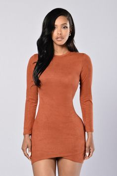 - Available in Black, Camel, Taupe and Olive - Crewneck - Long Sleeve - Suede Feel - Asymmetric Hem - Made in USA - 95% Polyester 5% Spandex