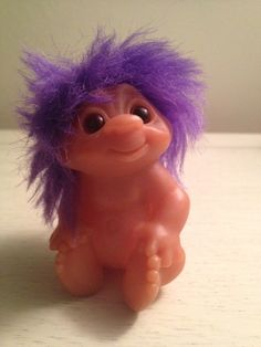 Infant troll. Loving that purple hair.