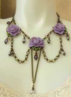 Festoon style necklace by Brenda Sue Lansdowne of B'sue Boutiques.   Bead and link chain and resin flowers are available at our website.