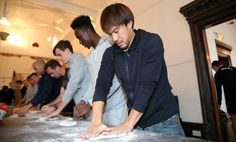 Shinji Okazaki rolls his base during Leicester City's visit to Peter Pizza, Leicester, after manager Claudio Ranieri kept his promise of pizza for his squad after keeping their first clean sheet of the season