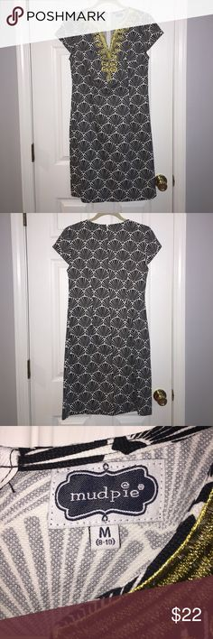Sea Shell Print Mud Pie Dress Black and White Sea shell print. Gold design around v-neck. Cap sleeves. Zipper down the back. Great for showers or afternoon parties. Mudpie runs large. This dress is a medium but I had the top of the dress taken in to fit like a small. Mud Pie Dresses