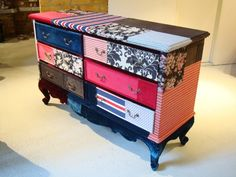 Each fabric piece is decoupaged onto the dresser.
