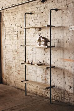 tall wood and metal wall shelving unit  $689.00