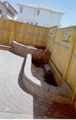 Brick flower bed. I would love to have something like this in our back yard.