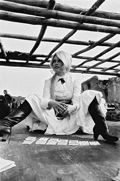 Brigitte Bardot plays solitaire between takes on the set of 'Shalako', 1968.