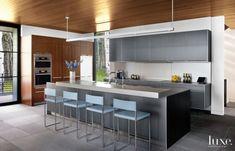 Modern Neutral Kitchen with Stainless-Steel Backsplash