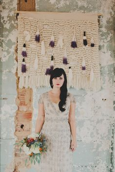 yarn ceremony backdrop // photo by Red White & Green Photography // http://ruffledblog.com/nature-inspired-autumn-wedding