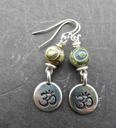 Silver plated Ohm charms and green gemstone earrings. Sterling silver. Small…
