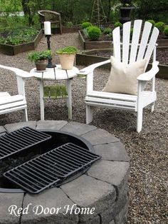 white adirondack chairs and fire pit