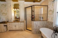 A combination of polished travertine and geometric cut stone compliment the soothing colors of this Master Bath Retreat.  Design by Miller Caudle, Stone through Carpets by Ozburn.