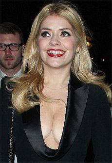 Holly Willoughby tops best breasts at National Cleavage Day  As the owner of some of the most talked about breasts in showbusiness, it's no surprise that This Morning presenter Holly Willoughby, 32, should take the crown for best cleavage of the year.The mother of two can shake off any worries that she'll be overshadowed by new buxom Celebrity Juice co-presenter Kelly Brook as she takes the best cleavage. Check out at:http://www.womenfitness.net/news/other/hollyWilloughby_tops.htm