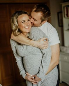 In-home maternity shoot in Minneapolis, Minnesota. Lifestyle maternity shoot including nursery shots. What to wear for maternity photos. Denver maternity photographer.