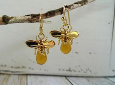Items similar to Sweet as can Bee. Gold Plated Honey Bee Drop Earrings with a Czech Glass Bead on Etsy Czech Glass Beads, Bee, Drop Earrings, Jewellery, Canning, Unique Jewelry, Handmade Gifts, Gold, Etsy