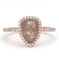 One-of-a-kind Fourteen Karat (14K) Rose Gold ring featuring a 1.25 carat Fancy Pear Shape Diamond that is light brown/champagnge in color.