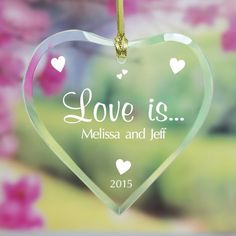 """Perzonalized """"Love Is…"""" Glass Heart Christmas Ornament from sherrykeepsakes. This is a very memorable glass ornament for your Christmas tree, and would make a perfect gift for a loved one. #scottsmarketplace"""