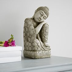Bring a little Zen into your home with this serene Buddha statue. It's perfect…