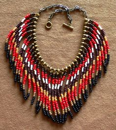PRICE REDUCED Native  PRICE REDUCED Native American tribal style fringed necklace in red, black, brown and gold