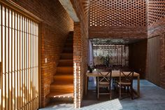 brick home by tropical space is conceived as a termite's nest