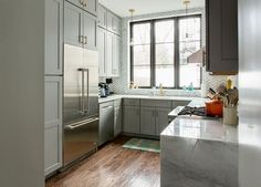 This brownstone in Park Slope got a bold exterior paint job and a modern interior face lift.
