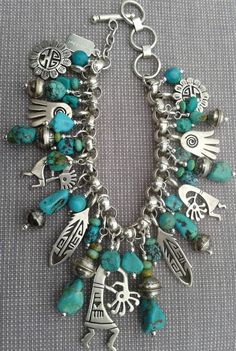 Charm bracelet of silver and turquoise. My birthday is coming up...hint, hint. LOL