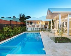 Inspiration for a large beach style backyard rectangular pool house remodel with travertine pavers. #travertinepavers