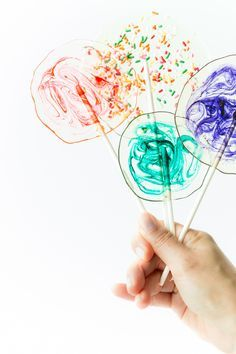 DYI Homemade Boozy Lollipops with colorful swirls - easily customizable with food colorings, alcohol, & flavor extracts.