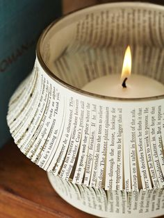 This candle holder is just one example of The 15 Most Horrific Crafting Abuses Ever Committed Against Books.  A fun page for those who flinch at books used in crafts because they love reading them!